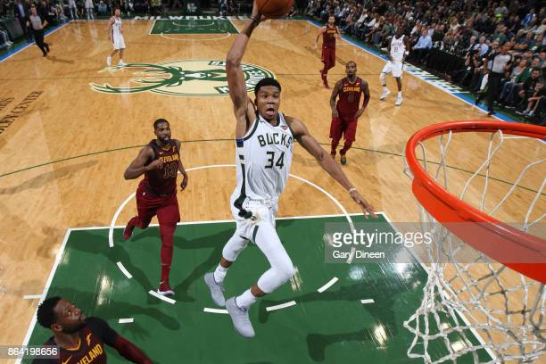 Giannis Antetokounmpo of the Milwaukee Bucks foes up for a dunk against the Cleveland Cavaliers on October 20 2017 at the BMO Harris Bradley Center...