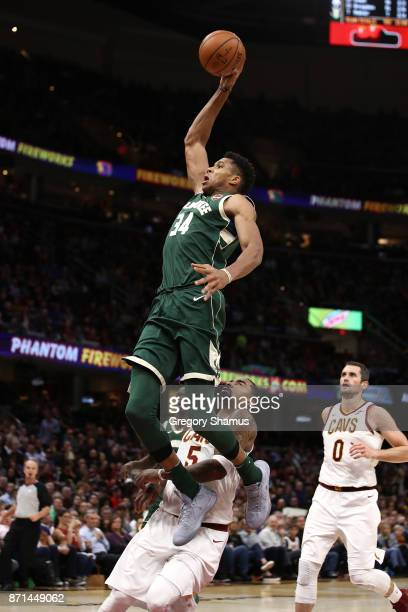 Giannis Antetokounmpo of the Milwaukee Bucks gets to the basket for a first half dunk past JR Smith of the Cleveland Cavaliers at Quicken Loans Arena...