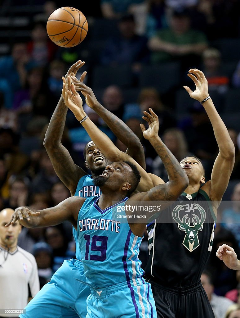 Giannis Antetokounmpo of the Milwaukee Bucks goes after a loose ball against teammates Marvin Williams and PJ Hairston of the Charlotte Hornets...