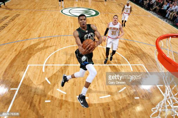 Giannis Antetokounmpo of the Milwaukee Bucks goes for a dunk during the game against the Atlanta Hawks on March 24 2017 at the BMO Harris Bradley...