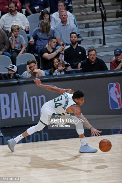 Giannis Antetokounmpo of the Milwaukee Bucks goes for a loose ball against the San Antonio Spurs on November 10 2017 at the ATT Center in San Antonio...