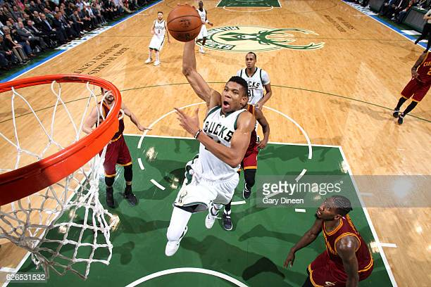 Giannis Antetokounmpo of the Milwaukee Bucks goes for the dunk during the game against the Cleveland Cavaliers on November 29 2016 at the BMO Harris...