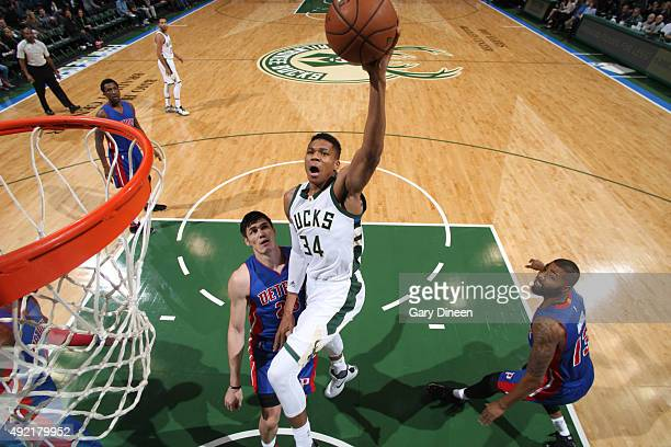 Giannis Antetokounmpo of the Milwaukee Bucks goes to the basket against the Detroit Pistons on October 10 2015 at the BMO Harris Bradley Center in...