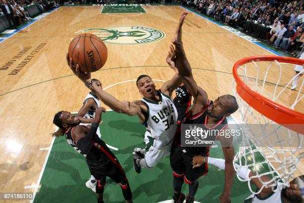 Giannis Antetokounmpo of the Milwaukee Bucks goes to the basket against the Toronto Raptors during Game Six of the Eastern Conference Quarterfinals...