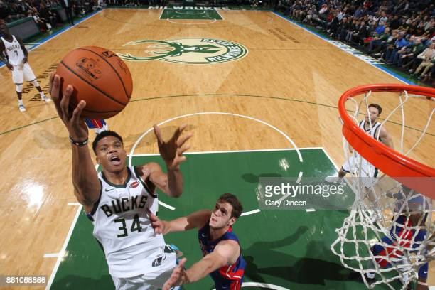 Giannis Antetokounmpo of the Milwaukee Bucks goes to the basket against the Detroit Pistons on October 13 2017 at the BMO Harris Bradley Center in...