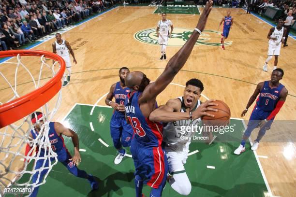 Giannis Antetokounmpo of the Milwaukee Bucks goes to the basket against the Detroit Pistons on November 15 2017 at the BMO Harris Bradley Center in...