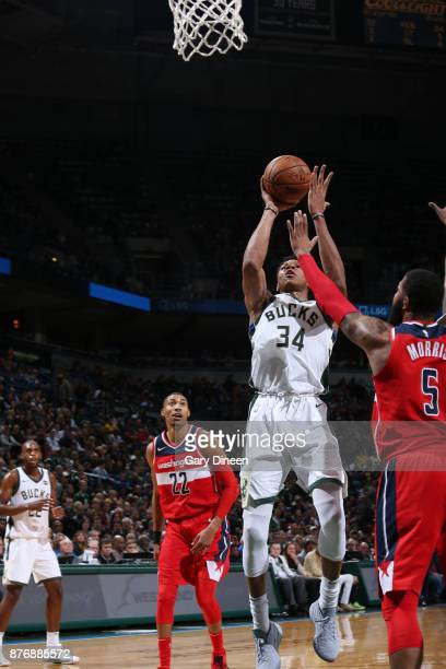 Giannis Antetokounmpo of the Milwaukee Bucks goes to the basket against the Washington Wizards on November 20 2017 at the BMO Harris Bradley Center...