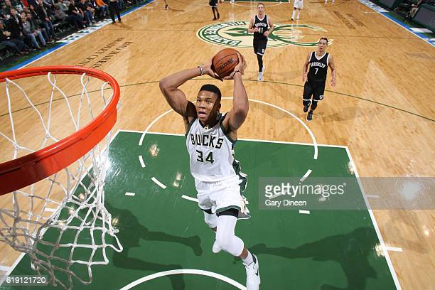 Giannis Antetokounmpo of the Milwaukee Bucks goes up for a dunk during a game against the Brooklyn Nets on October 29 2016 at BMO Harris Bradley...