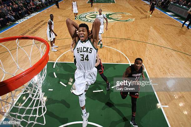 Giannis Antetokounmpo of the Milwaukee Bucks goes up for a dunk during a game against the Miami Heat on January 13 2017 at the BMO Harris Bradley...