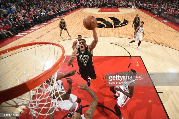 Giannis Antetokounmpo of the Milwaukee Bucks goes up for a dunk during a game against the Toronto Raptors in Round One of the Eastern Conference...