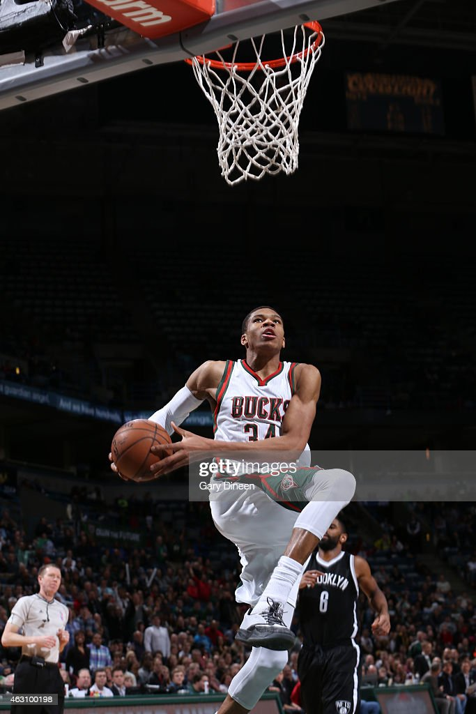 Giannis Antetokounmpo of the Milwaukee Bucks goes up for a dunk against the Brooklyn Nets on February 9 2015 at BMO Harris Bradley Center in...