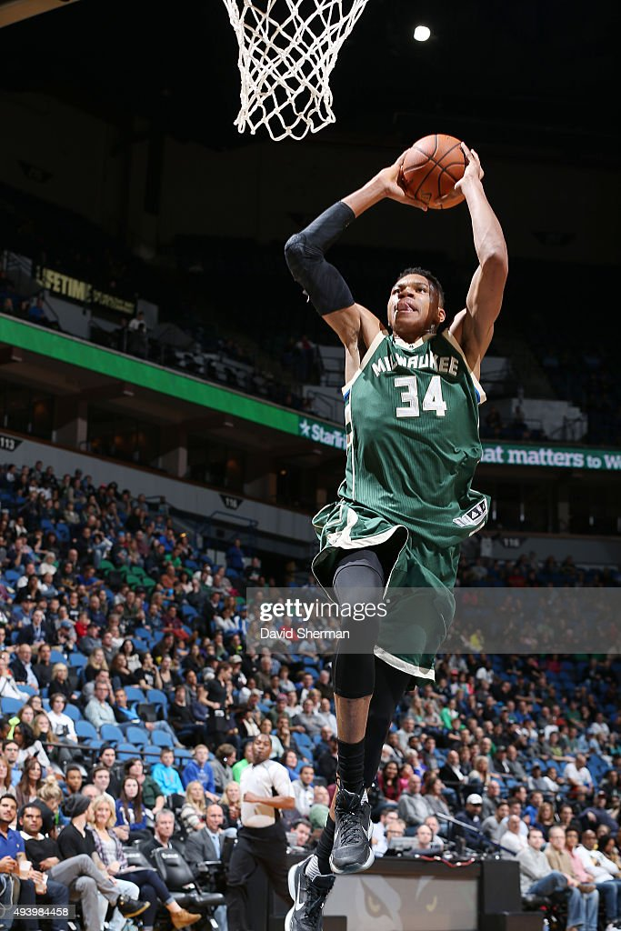 Giannis Antetokounmpo of the Milwaukee Bucks goes up for a dunk against the Minnesota Timberwolves during a preseason game on October 23 2015 at...
