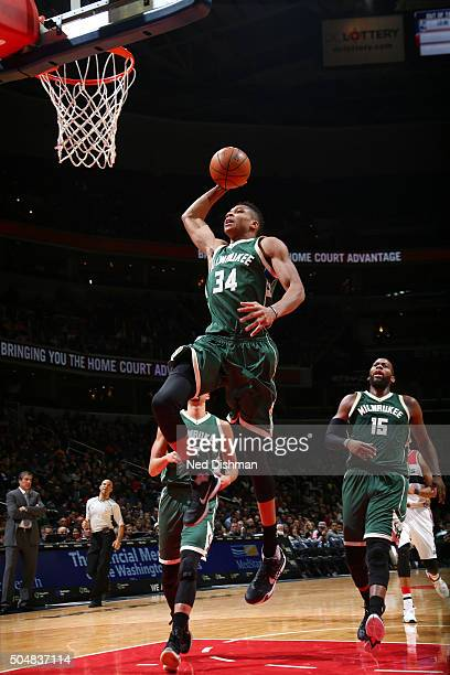 Giannis Antetokounmpo of the Milwaukee Bucks goes up for a dunk against the Washington Wizards on January 13 2016 at Verizon Center in Washington DC...