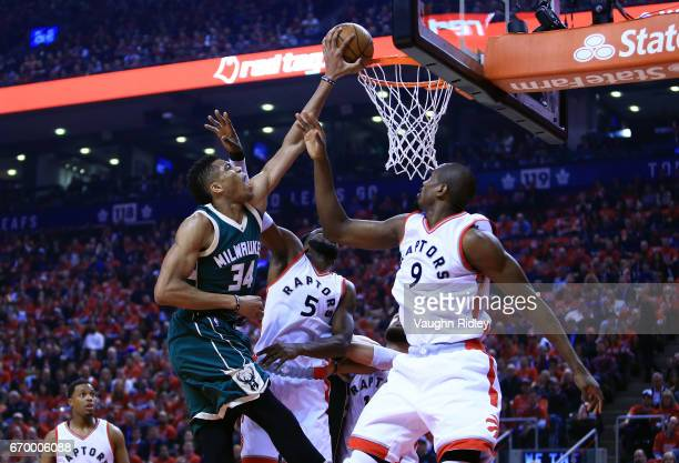 Giannis Antetokounmpo of the Milwaukee Bucks goes up for a shot as DeMarre Carroll and Serge Ibaka of the Toronto Raptors defend in the first half of...