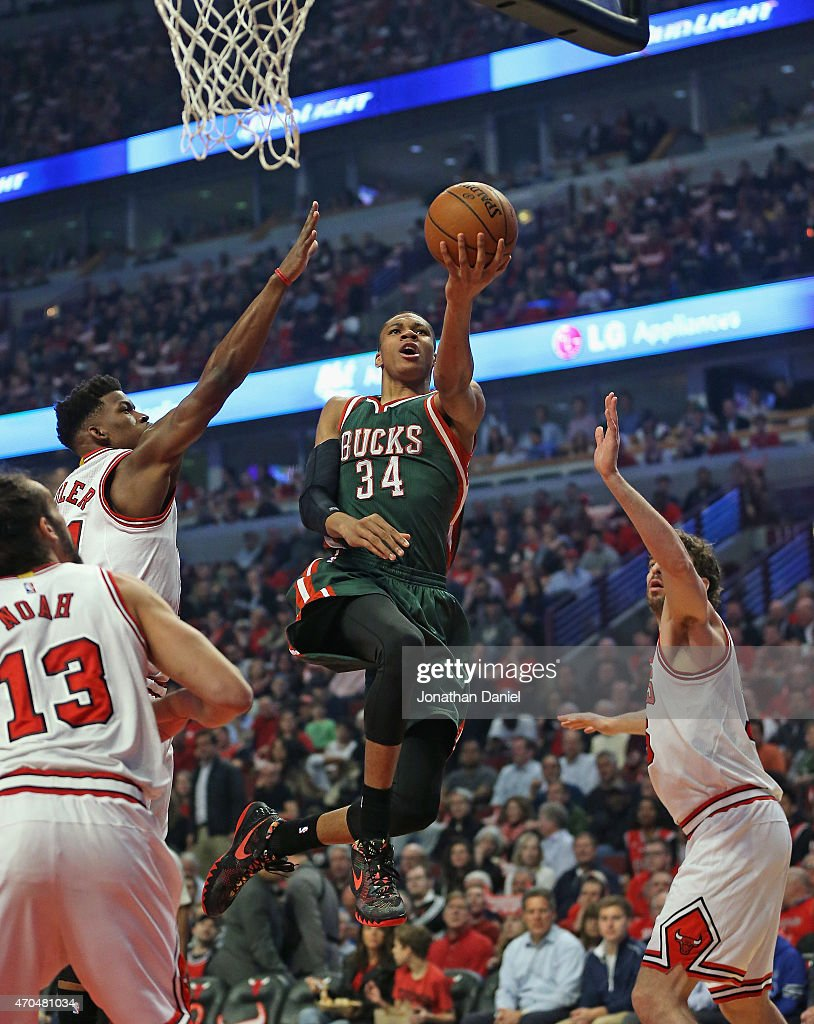 Giannis Antetokounmpo of the Milwaukee Bucks goes up for a shot over Joakoim Noah Jimmy Buter and Pau Gasol of the Chicago Bulls during the first...