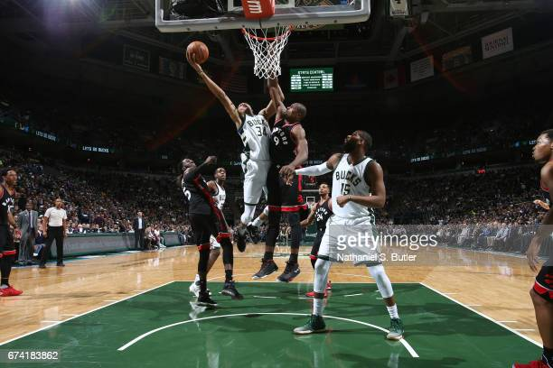 Giannis Antetokounmpo of the Milwaukee Bucks goes up for a shot against the Toronto Raptors during Game Six of the Eastern Conference Quarterfinals...