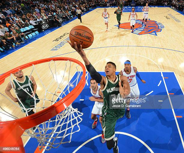 Giannis Antetokounmpo of the Milwaukee Bucks goes up for the layup against the New York Knicks at Madison Square Garden on November 6 2015 in New...
