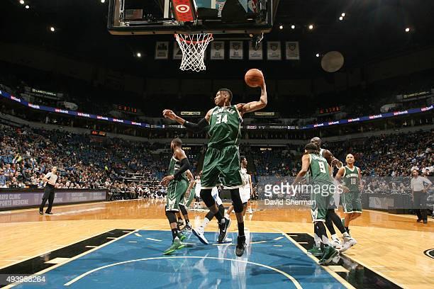 Giannis Antetokounmpo of the Milwaukee Bucks grabs the rebound against the Minnesota Timberwolves during a preseason game on October 23 2015 at...