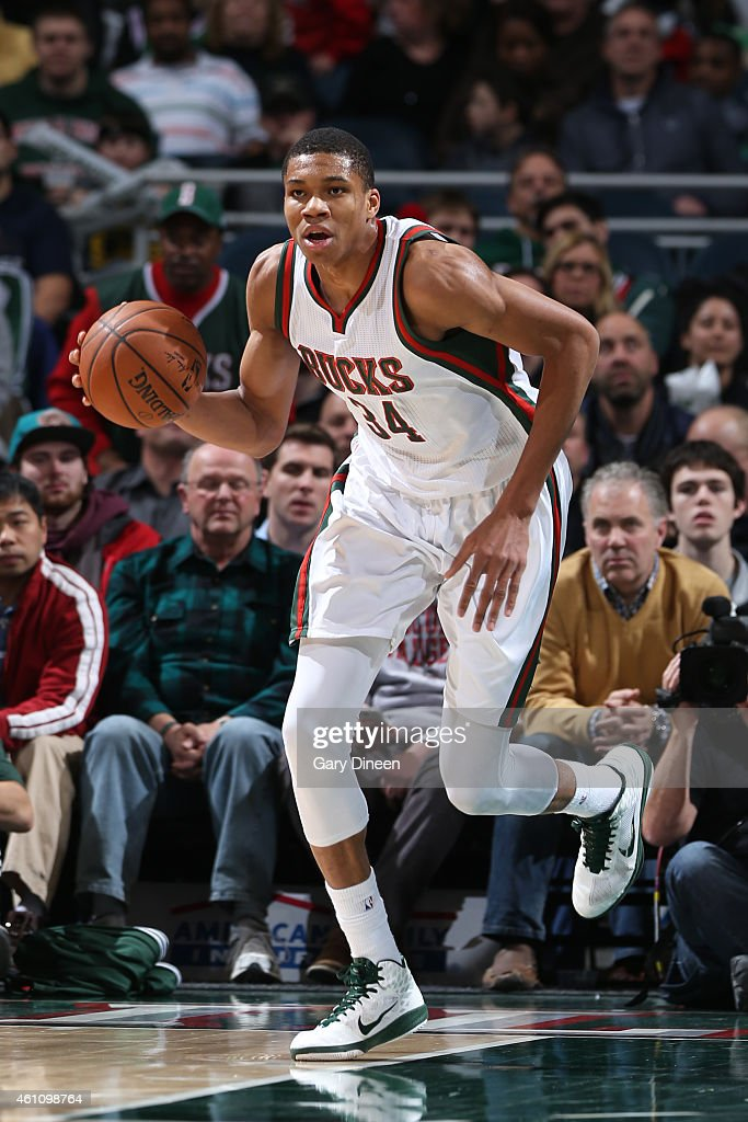 Giannis Antetokounmpo of the Milwaukee Bucks handles the ball against the Phoenix Suns on January 6 2015 at the BMO Harris Bradley Center in...