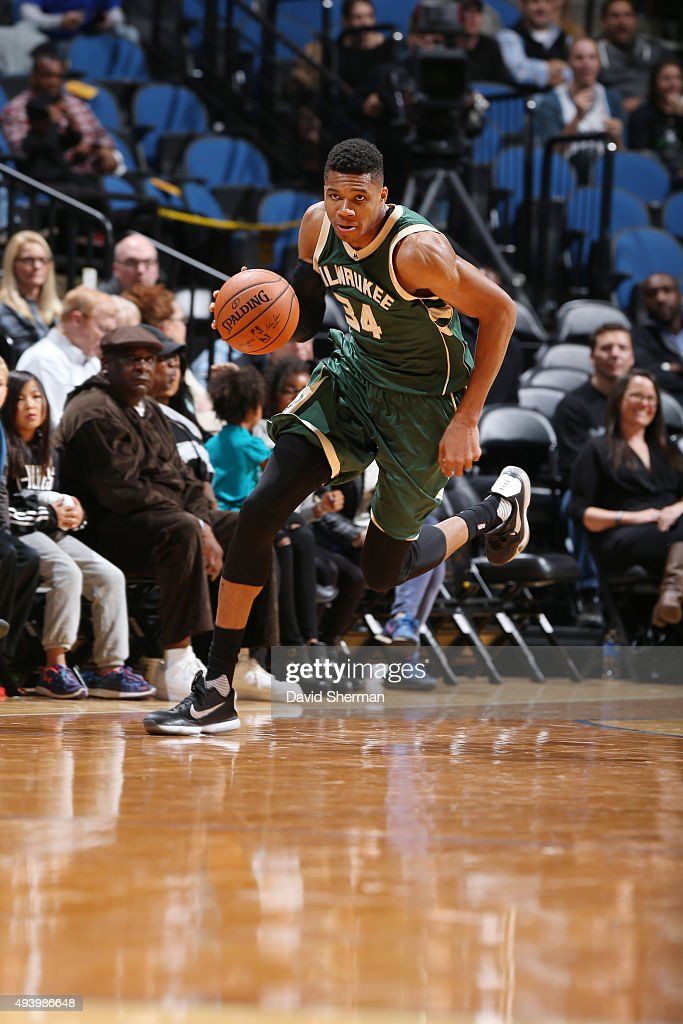 Giannis Antetokounmpo of the Milwaukee Bucks handles the ball against the Minnesota Timberwolves during a preseason game on October 23 2015 at Target...