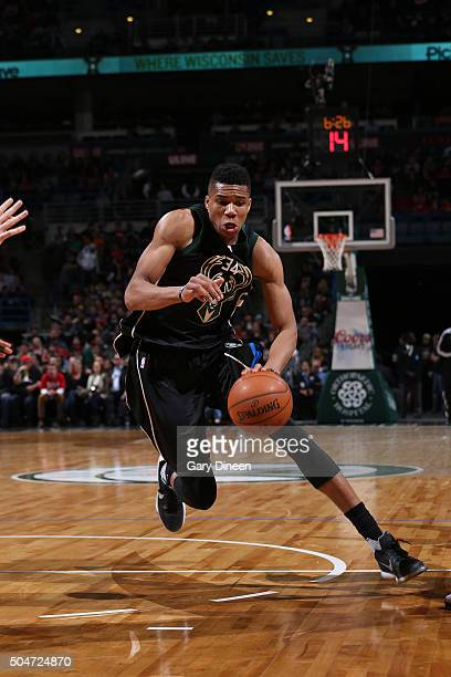 Giannis Antetokounmpo of the Milwaukee Bucks handles the ball against the Chicago Bulls on December 12 2016 at the BMO Harris Bradley Center in...