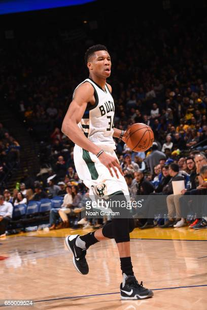 Giannis Antetokounmpo of the Milwaukee Bucks handles the ball against the Golden State Warriors on March 18 2017 at ORACLE Arena in Oakland...