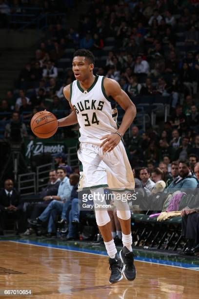 Giannis Antetokounmpo of the Milwaukee Bucks handles the ball against the Charlotte Hornets on April 10 2017 at the BMO Harris Bradley Center in...