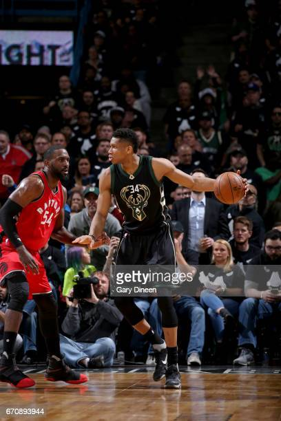 Giannis Antetokounmpo of the Milwaukee Bucks handles the ball against the Toronto Raptors during Game Three of the Eastern Conference Quarterfinals...