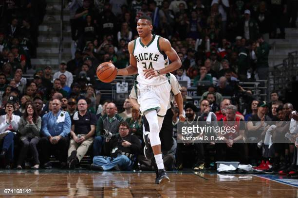 Giannis Antetokounmpo of the Milwaukee Bucks handles the ball against the Toronto Raptors during Game Six of the Eastern Conference Quarterfinals of...