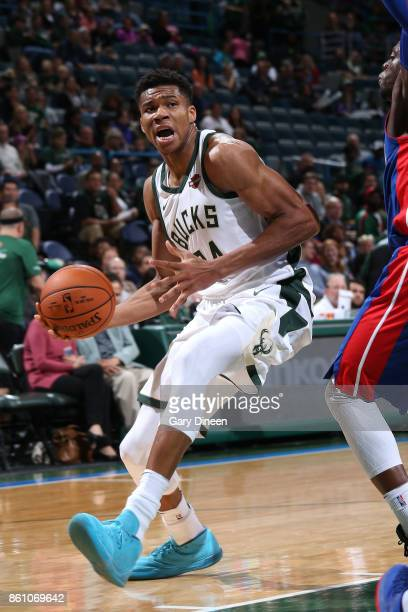 Giannis Antetokounmpo of the Milwaukee Bucks handles the ball against the Detroit Pistons on October 13 2017 at the BMO Harris Bradley Center in...