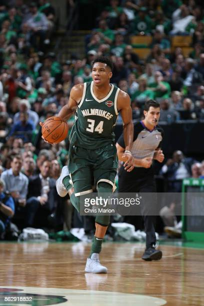 Giannis Antetokounmpo of the Milwaukee Bucks handles the ball against the Boston Celtics on October 18 2017 at the TD Garden in Boston Massachusetts...