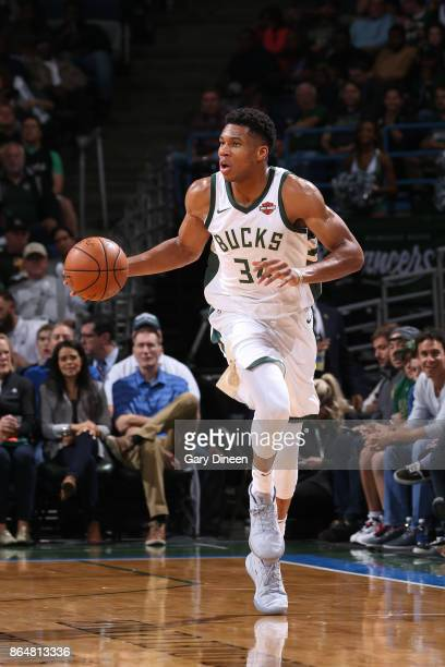 Giannis Antetokounmpo of the Milwaukee Bucks handles the ball against the Portland Trail Blazers on October 21 2017 at the BMO Harris Bradley Center...
