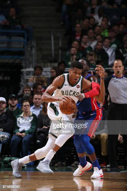 Giannis Antetokounmpo of the Milwaukee Bucks handles the ball against the Detroit Pistons on November 15 2017 at the BMO Harris Bradley Center in...