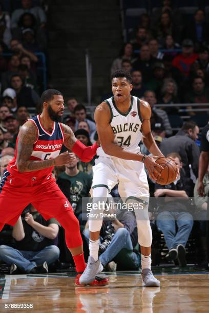 Giannis Antetokounmpo of the Milwaukee Bucks handles the ball against Markieff Morris of the Washington Wizards on November 20 2017 at the BMO Harris...