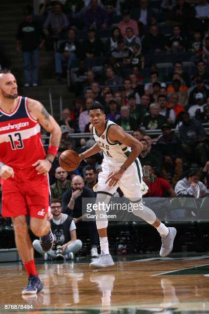 Giannis Antetokounmpo of the Milwaukee Bucks handles the ball against the Washington Wizards on November 20 2017 at the BMO Harris Bradley Center in...