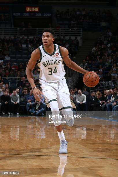Giannis Antetokounmpo of the Milwaukee Bucks handles the ball against the Utah Jazz on December 9 2017 at the BMO Harris Bradley Center in Milwaukee...
