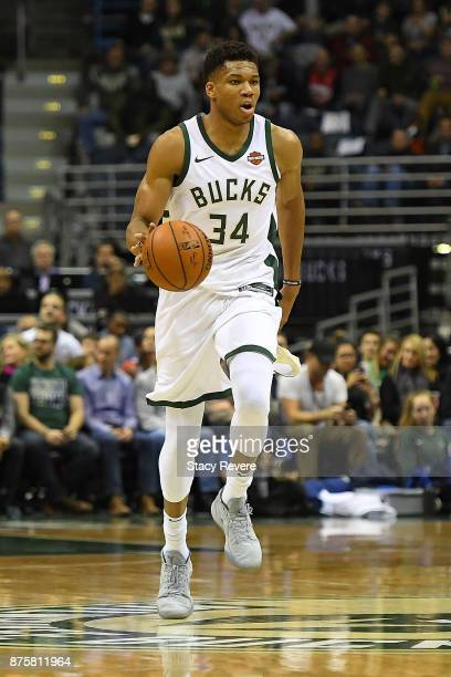 Giannis Antetokounmpo of the Milwaukee Bucks handles the ball during a game against the Detroit Pistons at the Bradley Center on November 15 2017 in...