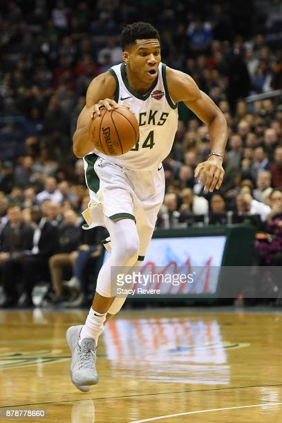 Giannis Antetokounmpo of the Milwaukee Bucks handles the ball during a game against the Washington Wizards at the Bradley Center on November 20 2017...