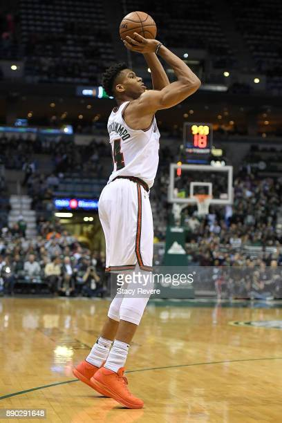 Giannis Antetokounmpo of the Milwaukee Bucks handles the ball during a game against the Dallas Mavericks at the Bradley Center on December 8 2017 in...