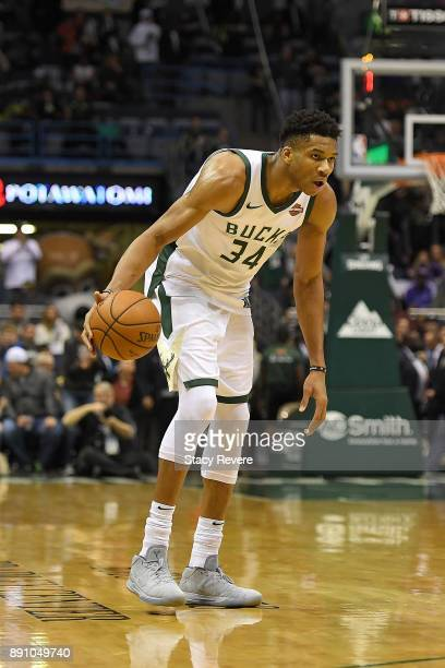 Giannis Antetokounmpo of the Milwaukee Bucks handles the ball during a game against the Utah Jazz at the Bradley Center on December 9 2017 in...