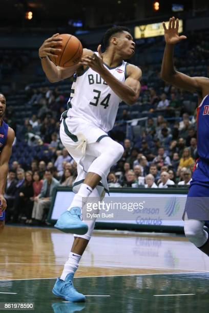 Giannis Antetokounmpo of the Milwaukee Bucks handles the ball in the first quarter against the Detroit Pistons during a preseason game at BMO Harris...