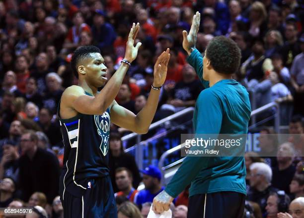 Giannis Antetokounmpo of the Milwaukee Bucks high fives a teammate in the second half of Game One of the Eastern Conference Quarterfinals against the...