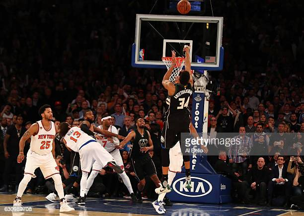 Giannis Antetokounmpo of the Milwaukee Bucks hits the winning basket as time runs out against the New York Knicks during their game at Madison Square...