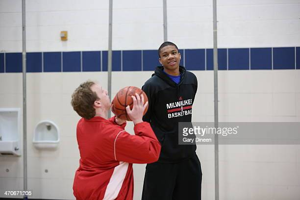 Giannis Antetokounmpo of the Milwaukee Bucks interacts with participants during a Special Olympics basketball skills clinic on February 11 2014 at...