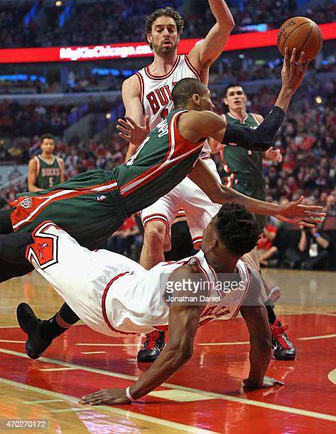 Giannis Antetokounmpo of the Milwaukee Bucks is called for a charge against Jimmy Butler of the Chicago Bulls during the first round of the 2015 NBA...