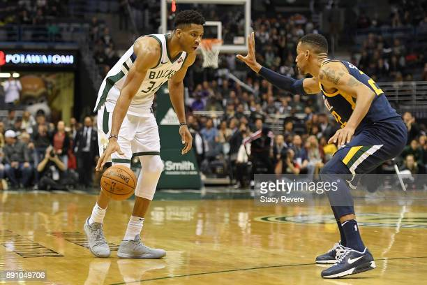 Giannis Antetokounmpo of the Milwaukee Bucks is defended by Thabo Sefolosha of the Utah Jazz during a game at the Bradley Center on December 9 2017...