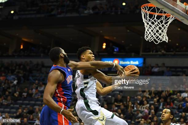 Giannis Antetokounmpo of the Milwaukee Bucks is fouled by Andre Drummond of the Detroit Pistons during the first half of a game at the Bradley Center...