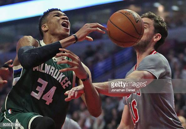 Giannis Antetokounmpo of the Milwaukee Bucks is fouled by Pau Gasol of the Chicago Bulls at the United Center on January 5 2016 in Chicago Illinois...