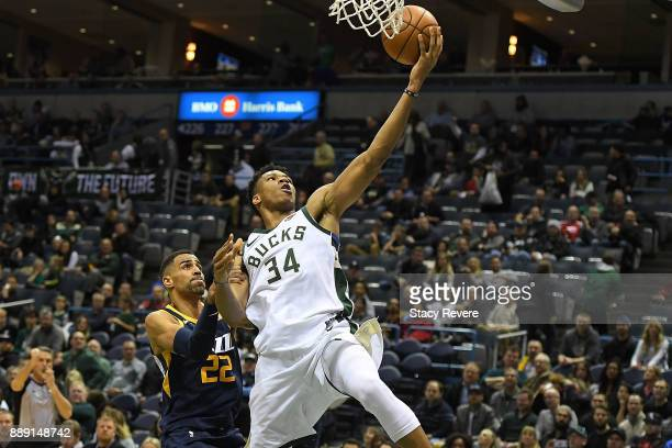 Giannis Antetokounmpo of the Milwaukee Bucks is fouled by Thabo Sefolosha of the Utah Jazz during the second half of a game at the Bradley Center on...