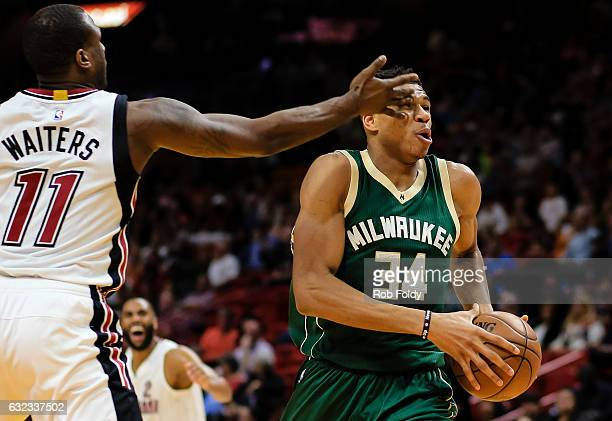 Giannis Antetokounmpo of the Milwaukee Bucks is hit in the eye by Dion Waiters of the Miami Heat during the first half of the game at American...